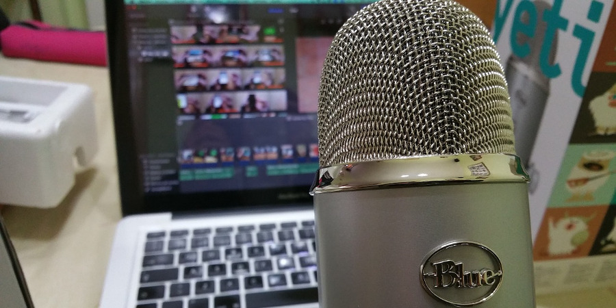 microphone and laptop being used for making a successful podcast
