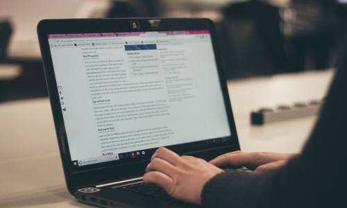 woman writing content to boost engagement on her website