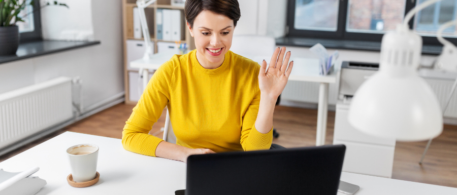 young woman talking to her staff on a video call when working from home